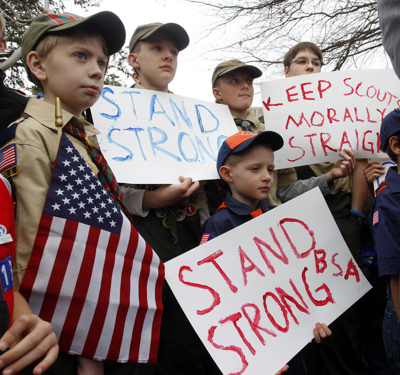 Scouts take part in a prayer vigil and rally at Boy Scout national headquarters in Irving, Texas, on Wednesday to urge keeping the policy excluding gay Scouts and leaders.