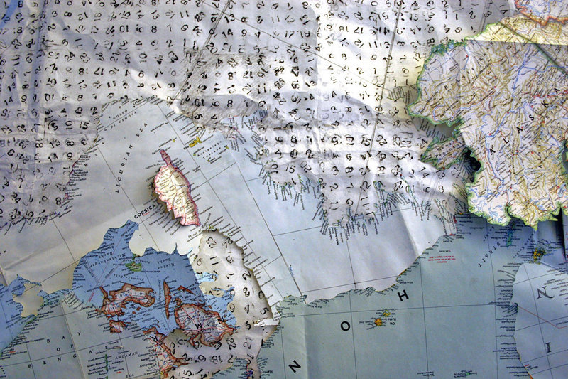 """Detail of """"Map of the World"""" by Cynthia Davis, from """"Standing Navigation on the End of a Needle,"""" her installation at the Coleman Burke Gallery in Brunswick, continuing through March 16."""