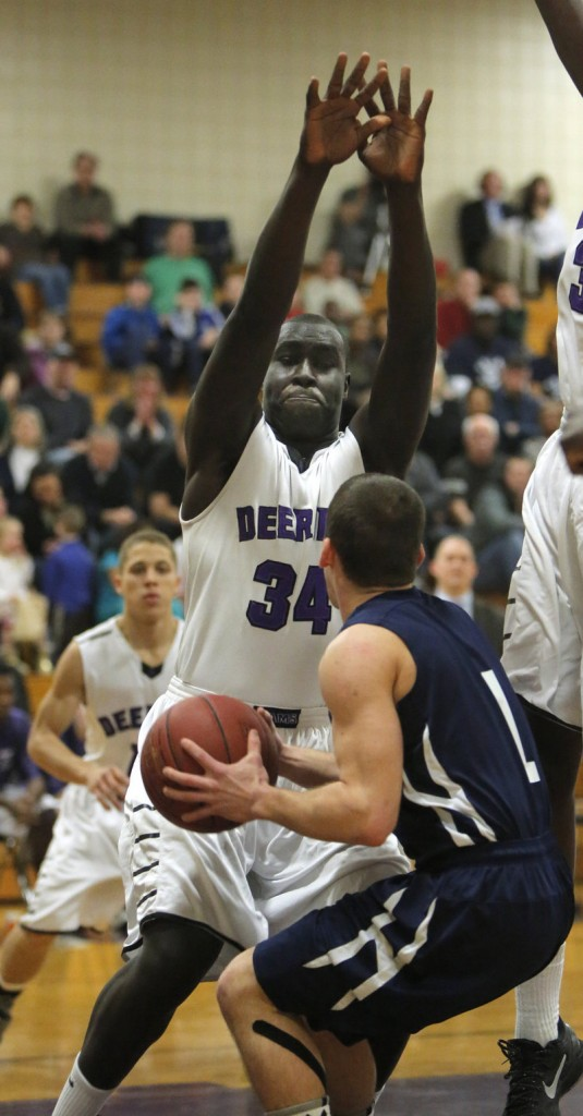 Thiwat Thiwat of Deering shows the type of defense that made scoring so difficult for both teams Thursday night, posing a formidable wall for Nick Volger of Portland. Deering won a regular-season finale, 37-30.