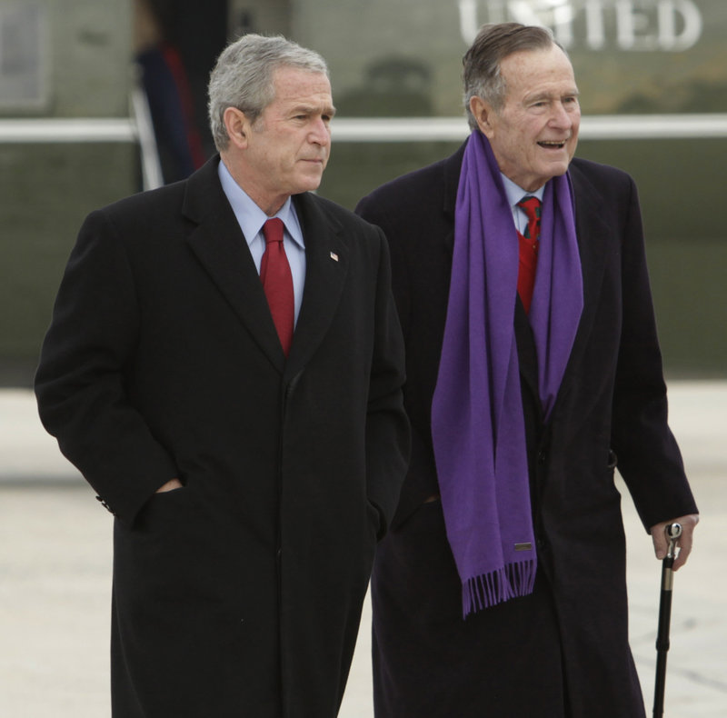 President George W. Bush walks with his father, former President George H.W. Bush, at Andrews Air Force Base, Md., in 2008.