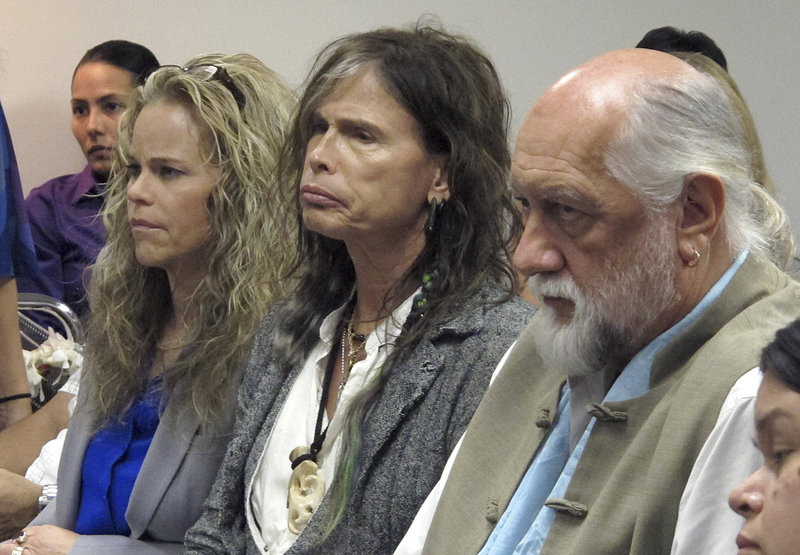 Aerosmith lead singer Steven Tyler, center, sits with Fleetwood Mac drummer Mick Fleetwood, right, as they listen to testimony on a celebrity privacy bill.