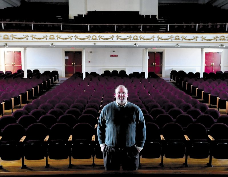 Skowhegan Chamber of Commerce Executive Director Cory King stands inside the Skowhegan Opera House. King says he has a plan to draw more performers.