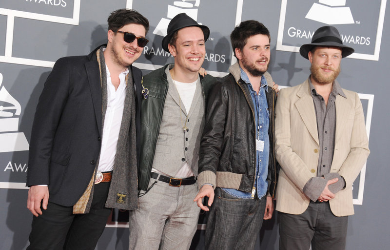 """From left, Marcus Mumford, Ben Lovett, Country Winston and Ted Dwane of Mumford & Sons arrive at the Grammy Awards on Sunday. Even the London folk-rockers themselves – stars of the 2012 Gentlemen of the Road Stopover in Portland – were surprised when their """"Babel"""" won album of the year."""