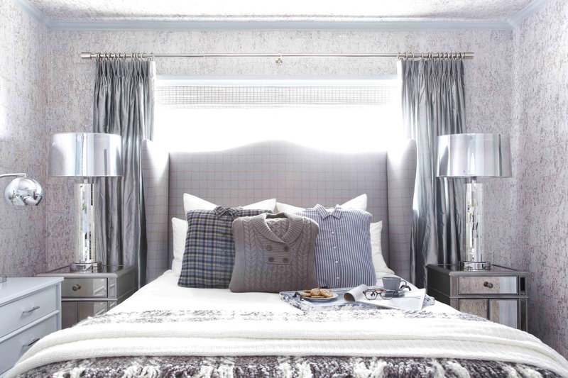 This guest bedroom designed by Brian Patrick Flynn includes a custom headboard made from men's suiting fabric and pillows made from hand-me-down sweaters and flannel shirts.