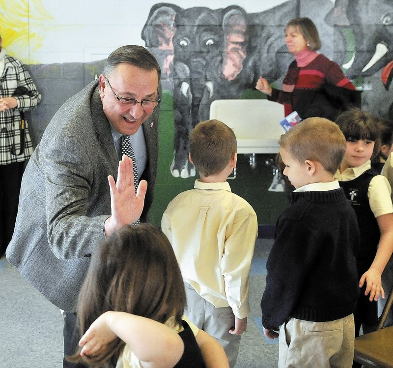 "Gov. LePage greets students after reading ""Baxter at the Blaine House"" at St. John Catholic School in Winslow earlier this month. By criticizing newspapers during his visit to the school, LePage took advantage of the fact that he had an audience that wouldn't disagree with him, a reader says."