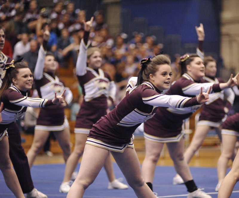Thornton Academy's cheering squad performs a routine in the Class A section of the state competition.