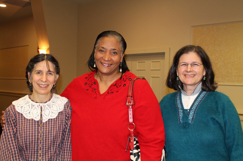 Civil War re-enactor Lucy Cunningham, left, with Marilyn Amoroso of Gorham and Deb Milite of Freeport, right.