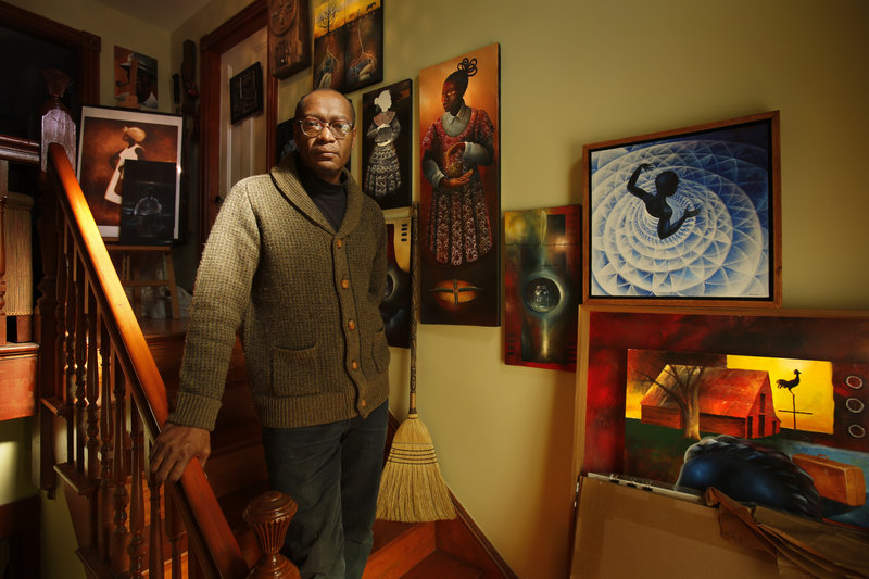 """Daniel Minter with a broom in his Portland home. """"I didn't know the author, but I loved her story,"""" Minter said of Kelly Starling Lyons and """"Ellen's Broom."""""""