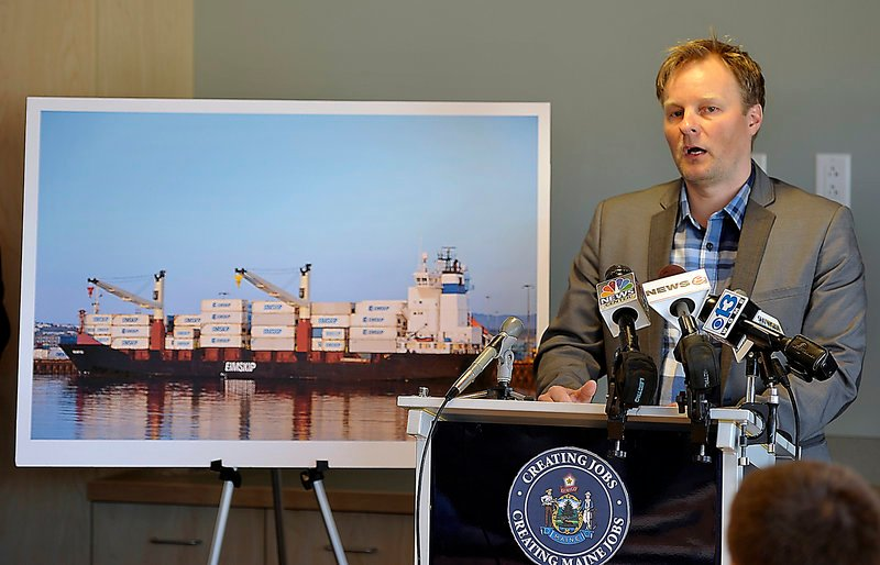Standing with a picture of an Eimskip operation, General Manager Larus Isfeld talks to the media Wednesday about coming to Portland.