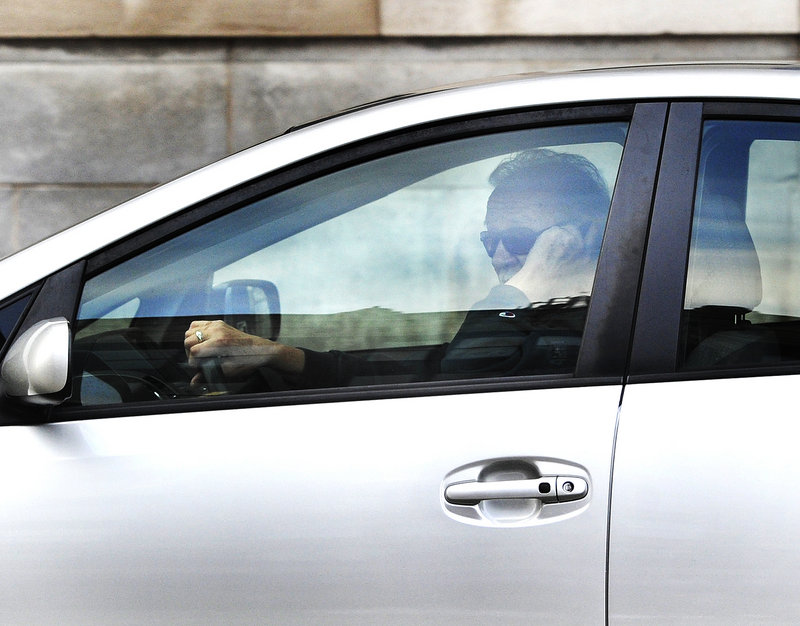 A driver talks on his cellphone while driving on Portland's Congress Street. Common sense and research tell us that using a cellphone is a distraction for drivers.