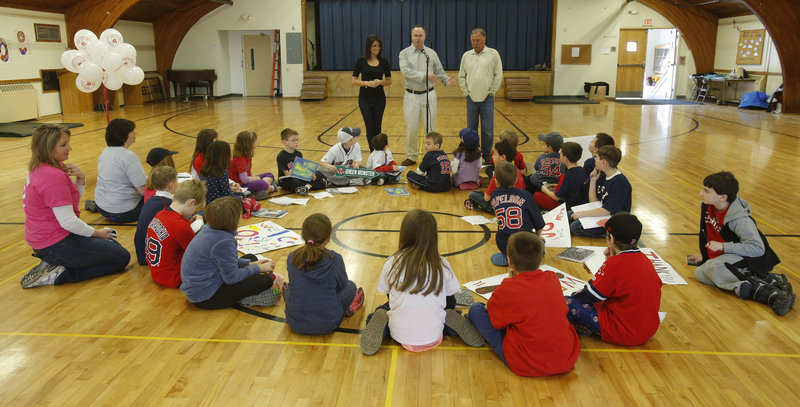 Jenny Dell, Don Orsillo and Jerry Remy, Red Sox announcers for the New England Sports Network, hold the attention of pupils at St. Brigid's School in Portland during a New England road show that brought them to Portland Thursday.
