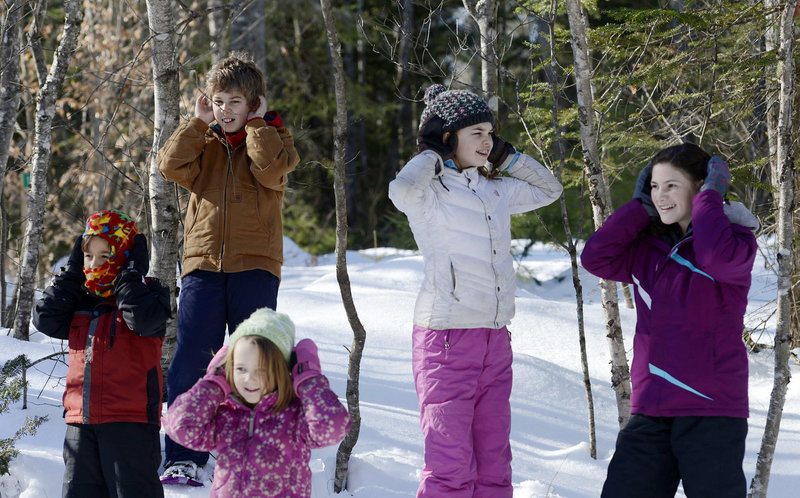 Glenn Powers' students aren't hearing no evil; they're attempting to view a snowy day in the woods from the keen senses of the critters who dwell there.