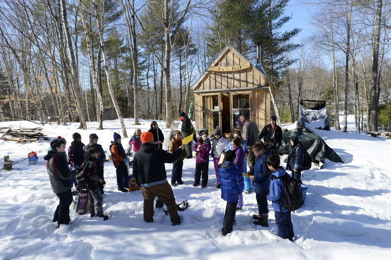 """Teacher Glenn Powers lectures students by the warming hut at the Hidden Valley Nature Center in Jefferson as part of the curriculum of the """"40 Days in the Woods"""" program."""