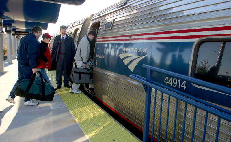 """Passengers board the Amtrak Downeaster in Portland in 2004. A reader takes issue with a state Department of Transportation prediction that """"a Lewiston/Auburn expansion would only carry an additional 30,000 riders."""""""