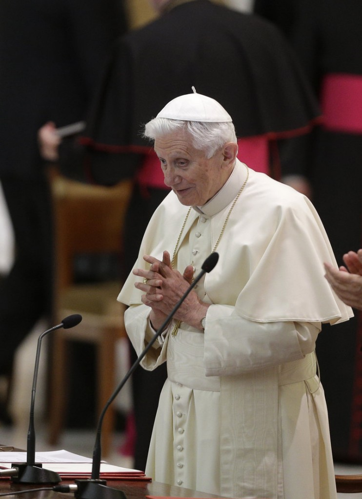 """Pope Benedict XVI prays during an audience with Roman priests Thursday in the Vatican. The papal election process grants authority to """"sexist yes-men cardinals"""" at the expense of elected priests, religious and laity, a reader says."""