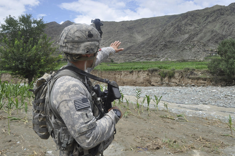 1st Lt. Doug Jones points across the Ghaki Valley road in Kunar province to where American and Afghan troops battled Taliban forces on June 27, 2010, when Staff Sgt. Eric Shaw of Exeter was killed on the road.