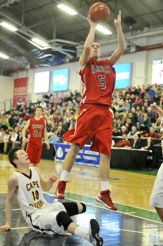 Dylan Stevens, right, of Wells puts up a shot after wrestling a rebound away from Eddie Galvin of Cape Elizabeth, but the Capers won 57-51 at the Expo.
