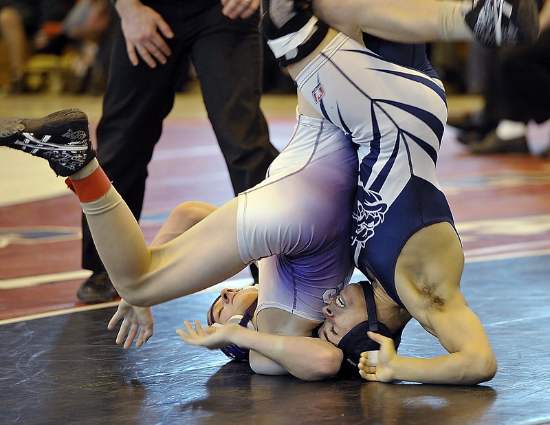Portland's Kidayer Aljubyly, right, performs a rolling maneuver during his semifinal match with Marshwood's Darren LaPointe. Aljubyly went on to capture the 106-pound title in the Class A state championships at Sanford High.