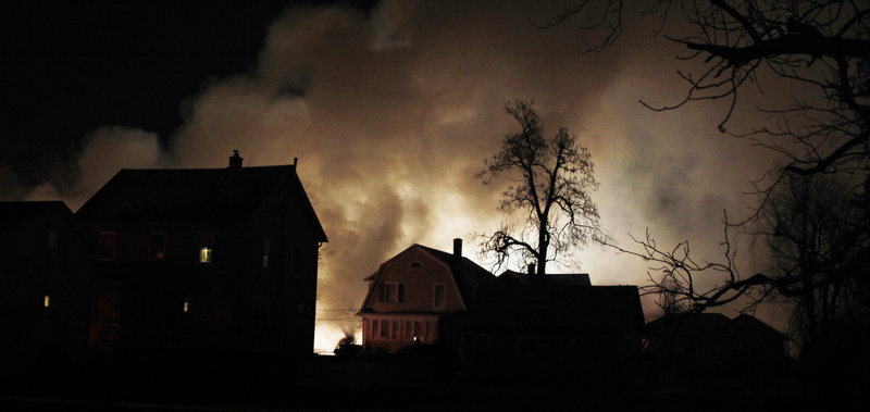 Smoke rises from a burning Continental Express commuter plane on Feb. 12, 2009, after it crashed into a home in suburban Buffalo, N.Y., killing 50 people.