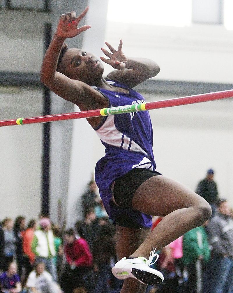 Rashad Zagon of Deering keeps her concentration while competing in the Class A high jump. She finished fifth with a height of 5 feet.