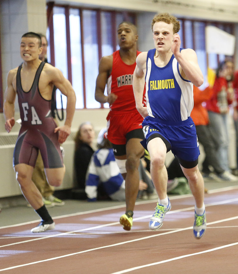 Jacob Buhelt of Falmouth surges to the finish line to win the Class B 200 meters in 23.23 seconds.