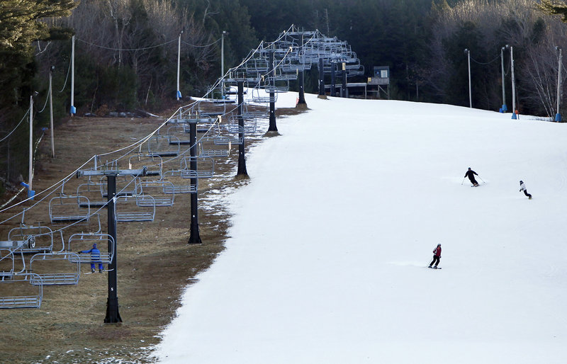 Man-made snow coats a ski run next to bare ground under a chairlift at the Shawnee Peak ski area in Bridgton on Jan. 5, 2012.