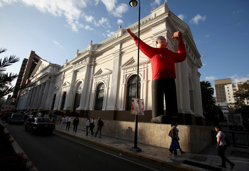 An inflatable doll depicting Venezuela's President Hugo Chavez occupies the front of the National Assembly in Caracas on Monday. Chavez announced his return on Twitter.