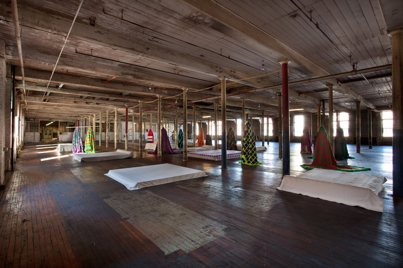 """""""Maine Mills Figures,"""" from the textile installations """"Color at the Center"""" by Fransje Killaars, on view through March 22 at the Bates College Museum of Art and Museum L-A/Bates Mill #1 (pictured) in Lewiston."""