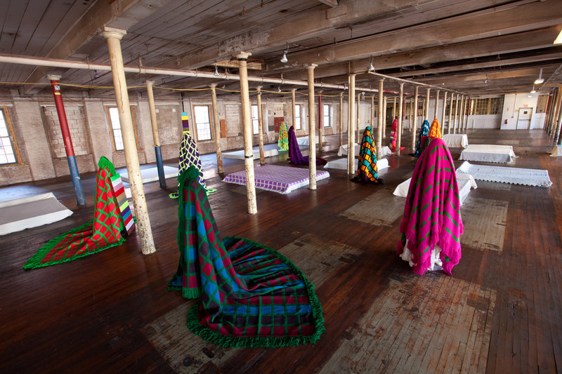 """""""Maine Mills Figures,"""" 2013, at Museum L-A."""