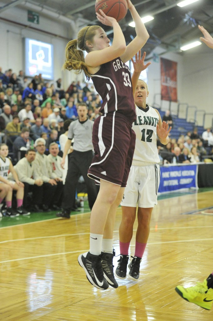 Jaclyn Storey, who scored 10 points for Greely, looks to shoot while defended by Meagan Dow of Leavitt in a Western Class B quarterfinal at the Portland Expo. Greely won, 42-27.