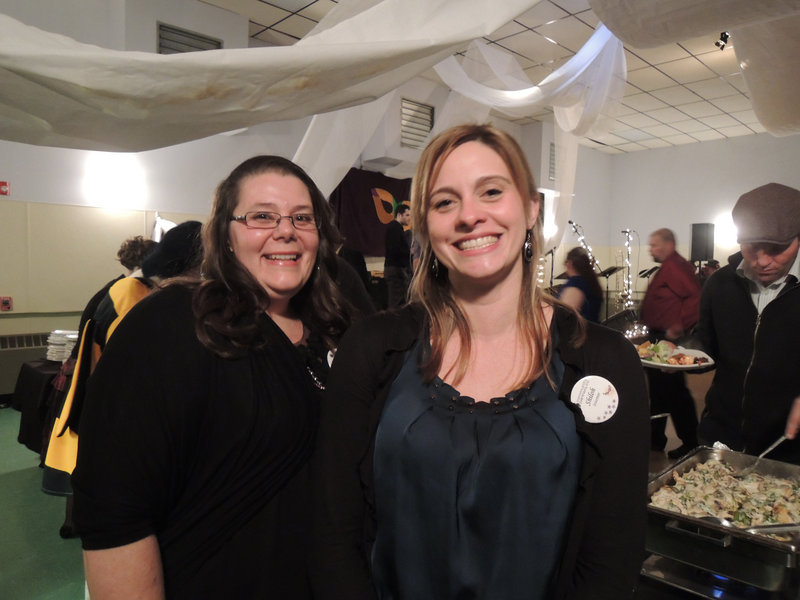 Community Partners co-workers Shiloh Legere of Lyman and Amy Duross of Saco, volunteering at the ball.