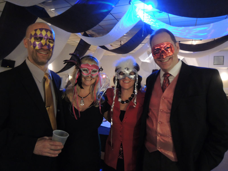 Embracing the evening's theme are Greg Patterson of Kennebunk, Heather Lynch of Gorham, Amy Safford, director of development for Community Partners, and her husband, Jon Safford of Kennebunk.
