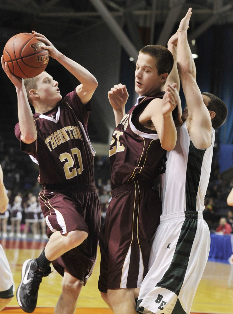 Evan Wright of Thornton Academy looks to shoot behind a screen set by teammate Kevin Barrett during the Western Class A semifinal against Bonny Eagle.