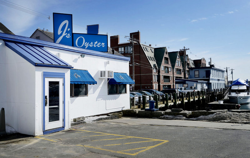 """Sitting just feet from the harbor on Portland Pier, J's is a """"sleeves rolled up, slurp some oysters"""" kind of joint. And make no mistake: It is a joint."""