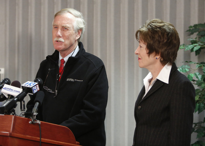 Sen. Angus King speaks at a news conference at Bath Iron Works on Thursday. At right is Sen. Susan Collins.