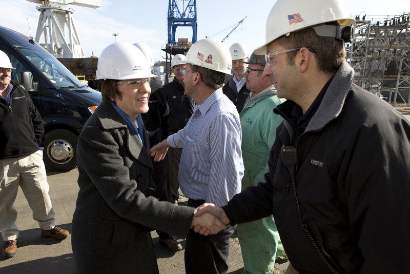 U.S. Sen. Susan Collins greets Bath Iron Works supervisor Chris Comora Thursday, Feb. 21, 2013, as she and Sen. Angus King toured the shipbuilding plant.