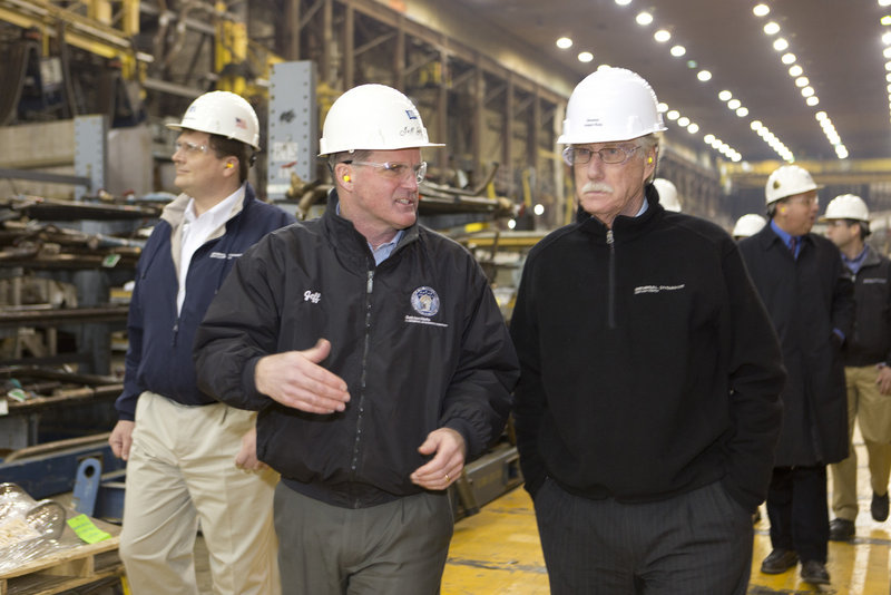 Bath Iron Works president Jeff Geiger talks with U.S. Sen. Angus King Thursday, Feb. 21, 2013, as King and Sen. Susan Collins toured the shipbuilding plant.