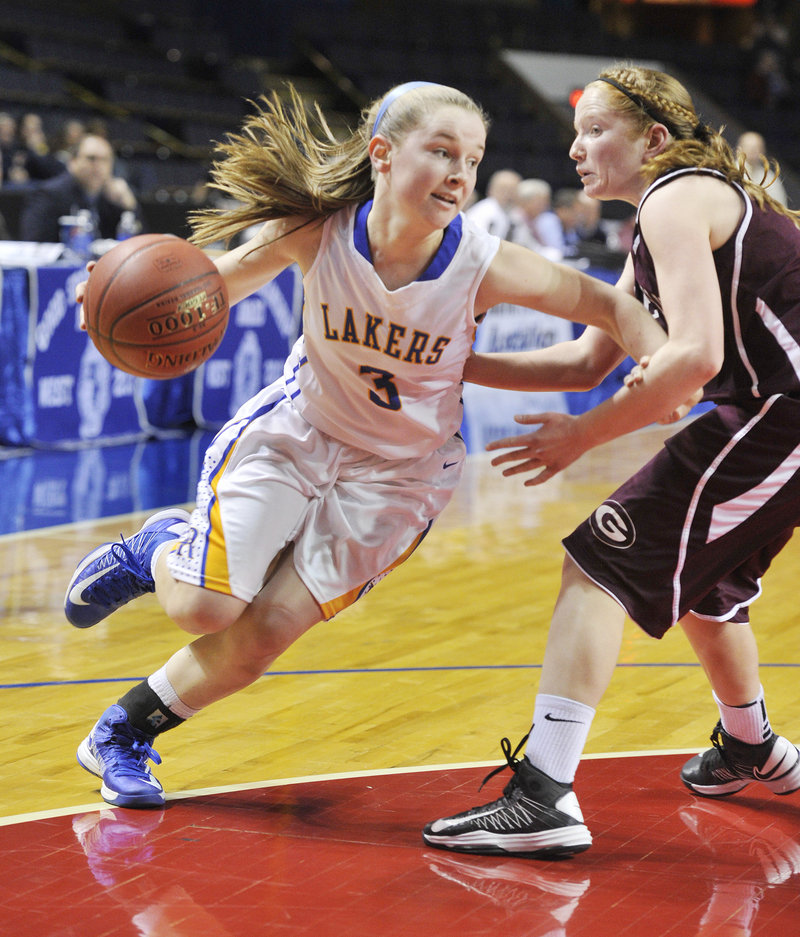 CeCe Hancock of Lake Region keeps Haley Felkel of Greely away while heading to the basket on a drive in their Western Class B semifinal.