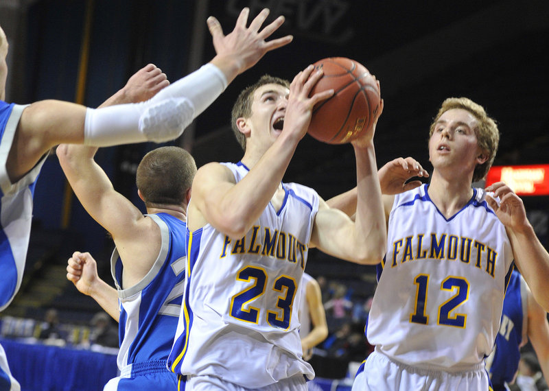 Charlie Fay of Falmouth pulls down a rebound next to teammate Tom Wilberg during a 58-22 win over Mountain Valley.