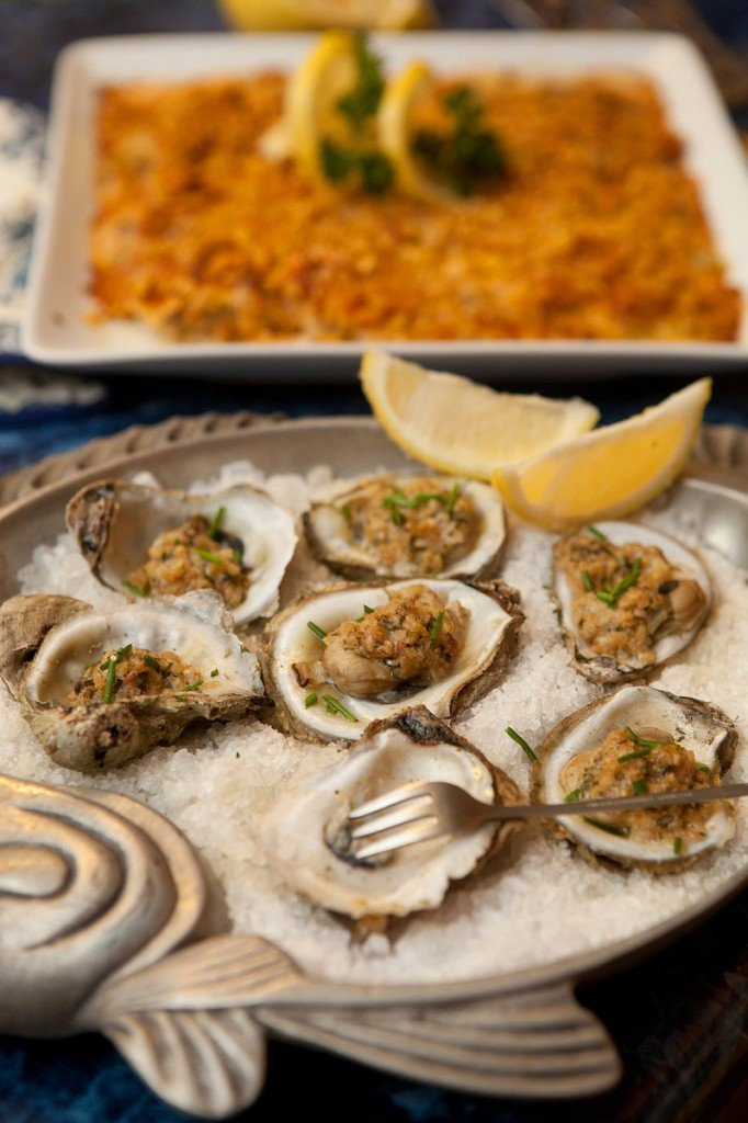 """Oysters Alexander, foreground, and oyster pie. Only five species of oysters are harvested for eating. """"The oyster from the Chesapeake Bay is the same species of oyster as the one from the Delaware Bay and on up to Maine and New Brunswick, Canada,"""" explains seafood wholesaler Robert Pidgeon. """"The flavor variation comes from the season, the salinity of the water they're growing in and even the way the tides fluctuate. There are any number of variables that determine that oyster's flavor."""""""