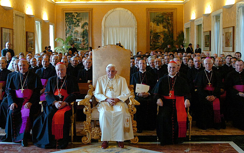 This 2006 photo shows Pope Benedict XVI at a meeting with outgoing Vatican Secretary of State Cardinal Angelo Sodano, left, and the current No. 2 official, Cardinal Tarcisio Bertone, right. Many think the next pontiff must have a solid track record managing a complicated bureaucracy.