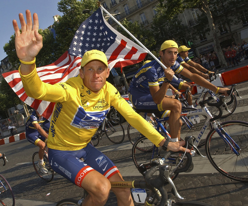 U.S. Postal Service cycling team leader and Tour de France winner Lance Armstrong rides the victory lap on the Champs-Elysees boulevard in Paris in 2004.