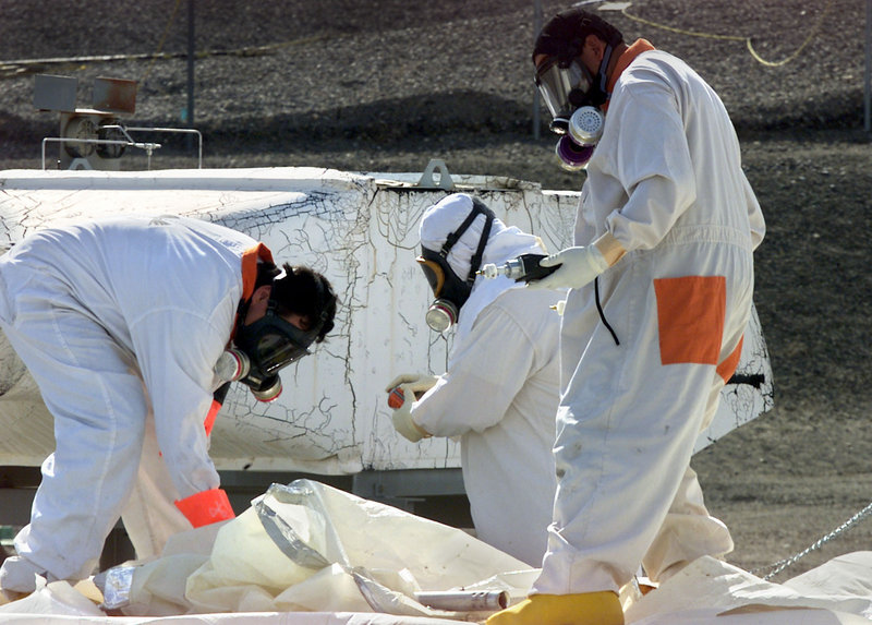 Workers at the Hanford nuclear reservation near Richland, Wash., measure for radiation in 2004. The site was created in the 1940s as part of the project to build the atomic bomb.