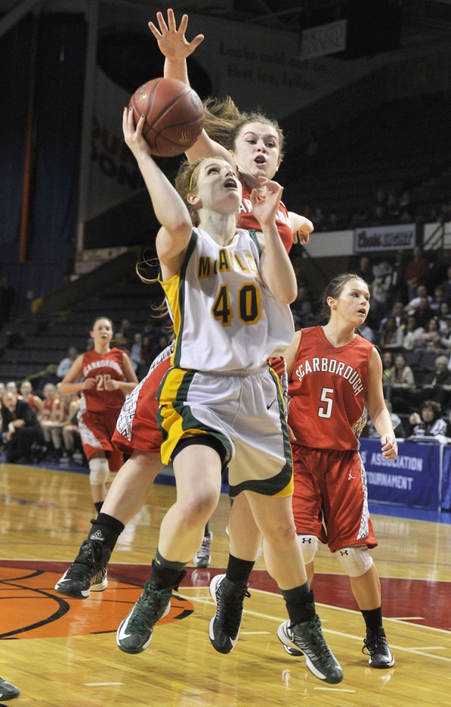 Jaclyn Welch of McAuley drives to the basket ahead of Courtney Alofs of Scarborough during McAuley's 47-38 victory Friday night in a Western Class A girls' basketball semifinal at the Cumberland County Civic Center.
