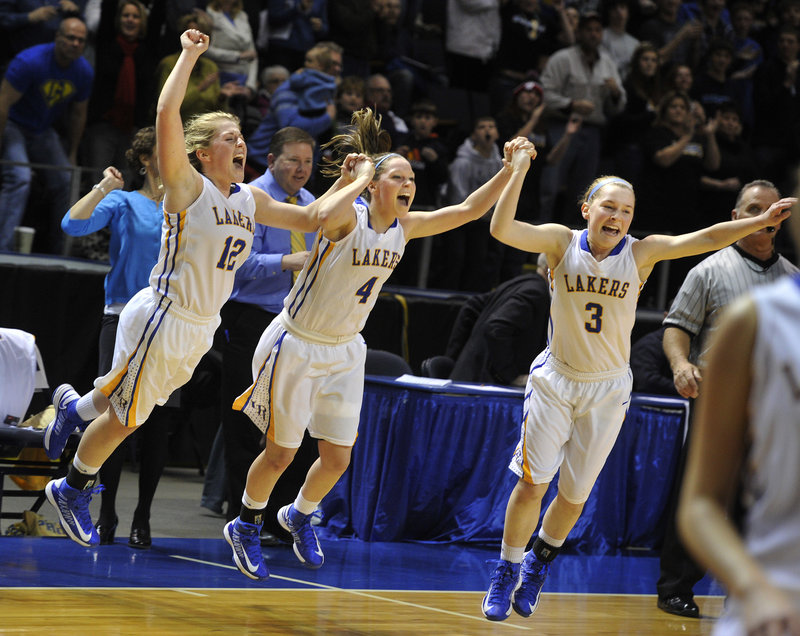 The Hancock girls, from left, Sarah, Sydney and CeCe, leap onto the court Saturday as Lake Region completes its victory against York in Western Class B.