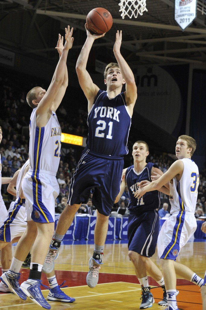 Aaron Todd, named the top player/sportsman of the Western Class B tourney, drives for York against Jack Simonds of Falmouth.