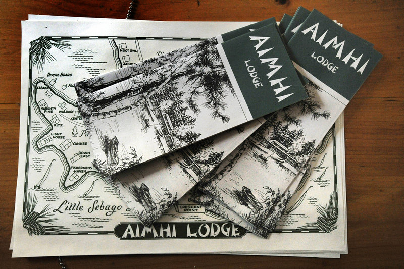 A stack of brochures and maps describe Aimhi Lodge and offer a guide to exploring the once-popular family lodge on Little Sebago Lake that featured two dozen cabins and a main lodge on 25 acres of waterfront land.