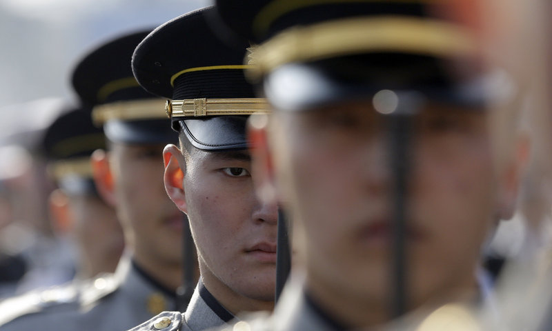 South Korean honor guards salute during a rehearsal of the presidential inauguration in Seoul, South Korea, on Sunday.