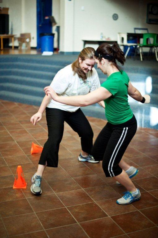 """Katie Bell and Tina Burnell play """"cone tag"""" during a Punk Rope class at Riverton Elementary School. The class begins with stretching and moves on to a series of mini-sessions that include jumping rope and schoolyard games. It's all set to """"fast and fun"""" music, says instructor Allison Kennie."""