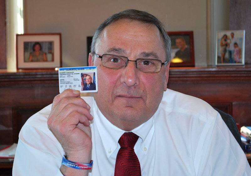 Gov. Paul LePage displays his permit to carry a concealed weapon. The Maine Legislature recently passed a temporary ban, proposed by LePage, on releasing the names of concealed-carry permit holders.